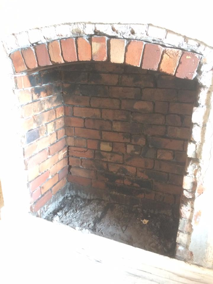 Fireplace Bricks after phase 1 of cleaning