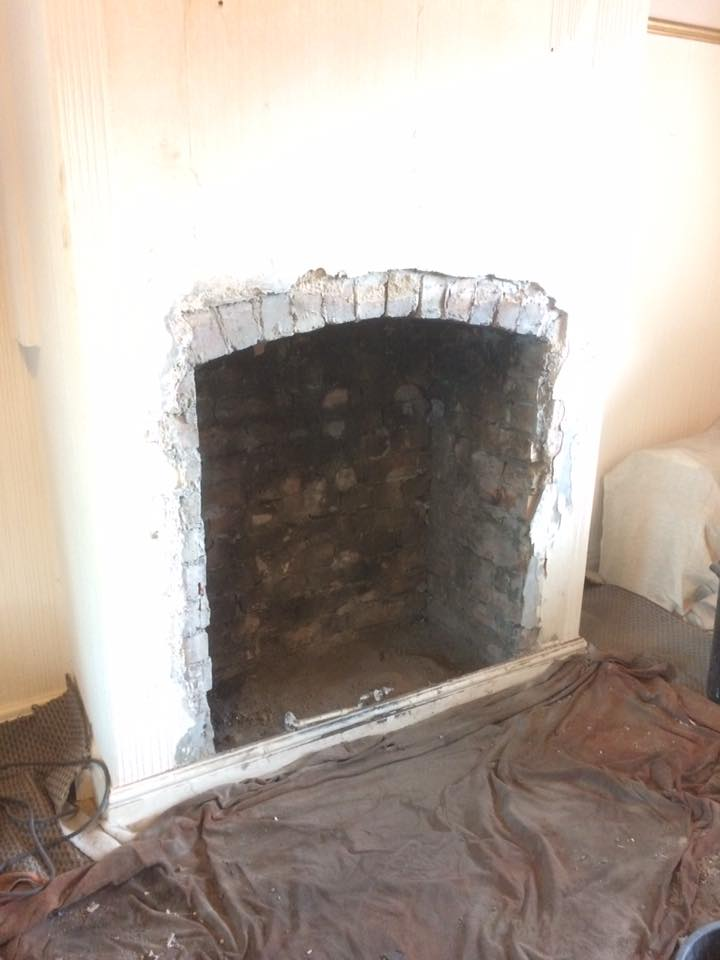 The finished fireplace knockout... Ready to be cleaned, repointed and plastered
