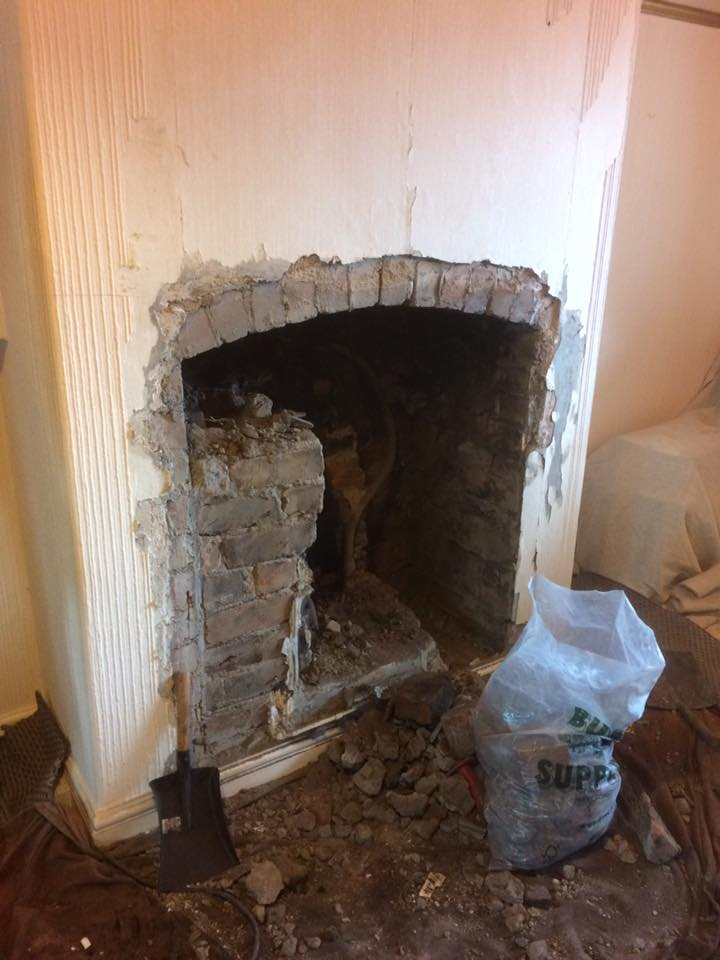 Fireplace knockout revealed a gorgeous arched lintel and red brick back wall